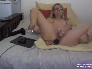 Mature blonde Alanna with glasses fucks her ass