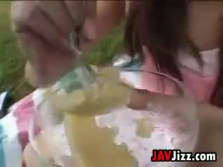 Kinky Asian Swallowing Cum And Food Outdoors