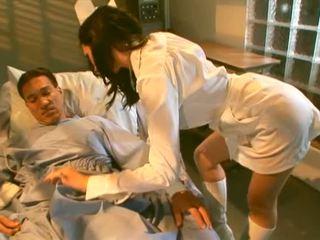 Pretty brunette nurse sucking her lucky patient