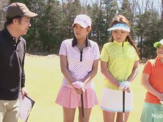 Cute Asian girls play a game of strip golf