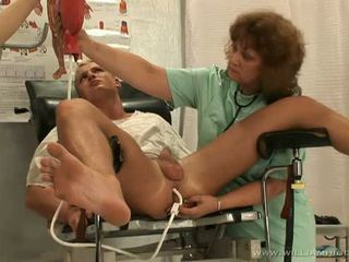 Horny guy getting her prostate stimulated by two hot nurses
