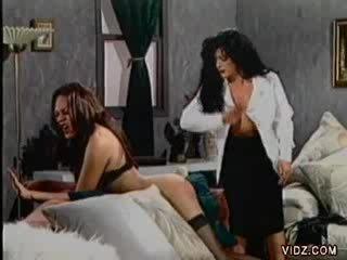 Brunette bitch sticks Dildo in shemale's butt