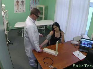 Dark haired babe fucked in fake hospital