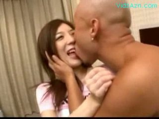 Shy Japanese girl being played with he...