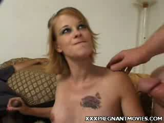 Preggy blond taking two cocks